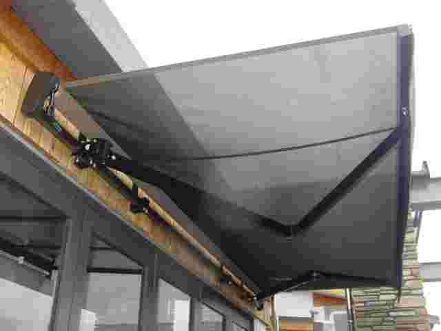 Retractable Awnings - Black Folding arm awning over cafe doors in Karaka 2 copy.jpg