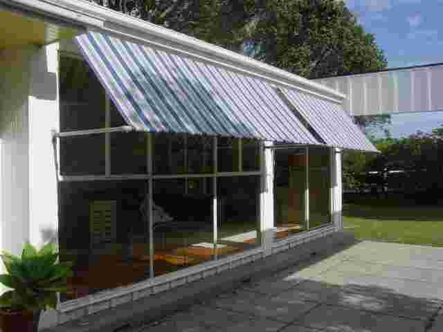 Retractable Awnings - Drop Awnings over 1970s Architectural home in Greenlane copy.JPG