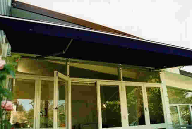 Retractable Awnings - Glass-Mounted-Folding-Arm-awning copy.jpg