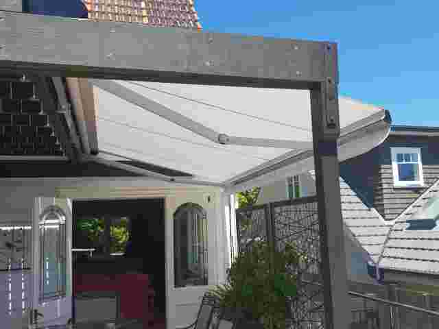 Retractable Awnings - Folding Arm Awning with white canvas over residential deck in Remuera copy.jpg