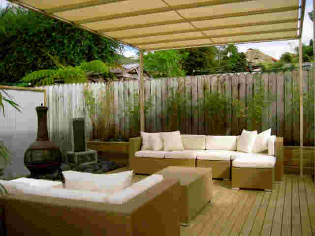 Retractable Awnings - Sunwise over outdoor furniture copy.jpg