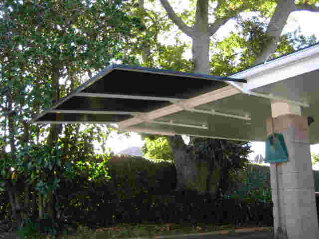Fixed Frame Awnings - Cantilevered angled Fixed Frame awning off carport in Remuera copy.jpg