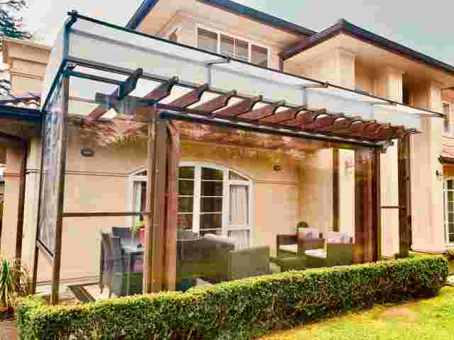 Fixed Frame Awnings - Curved Patio canopy on top of wooden pergola in St Heliers 2 copy.jpg