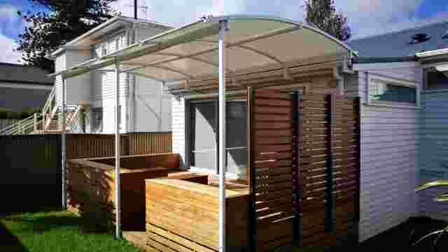 Fixed Frame Awnings - Curved Patio room AFTER in Ellerslie 1 copy.jpg