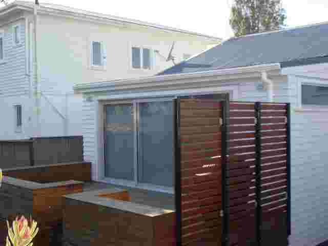 Fixed Frame Awnings - Curved Patio room BEFORE in Ellerslie copy.JPG
