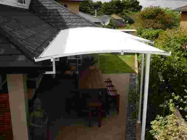 Fixed Frame Awnings - Curved Patio room in The Gardens copy.jpg