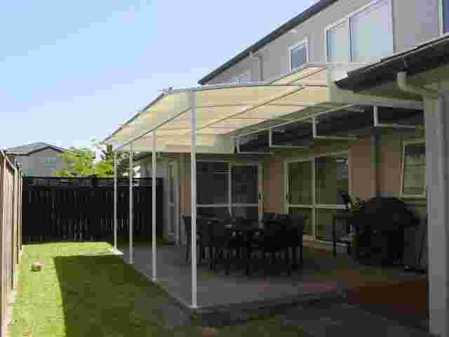 Fixed Frame Awnings - Curved Patio room over outdoor concrete patio1 copy.jpg