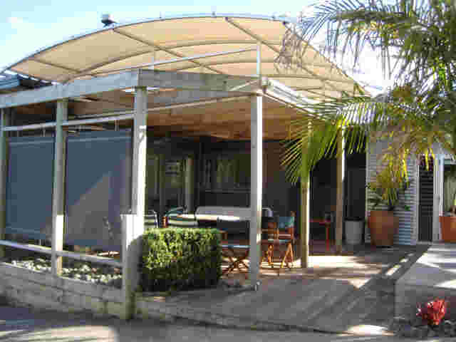 Fixed Frame Awnings - Curved Patio room on timber pergola in Auckland copy.jpg