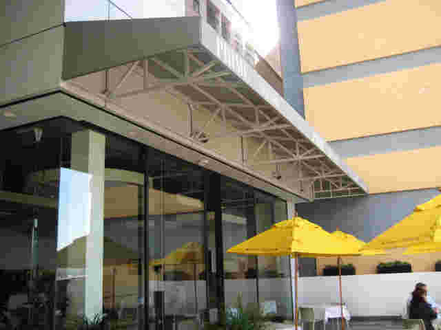 Fixed Frame Awnings - Fixed Frame Wedge awning over Bistro terrace in Auckland copy.jpg