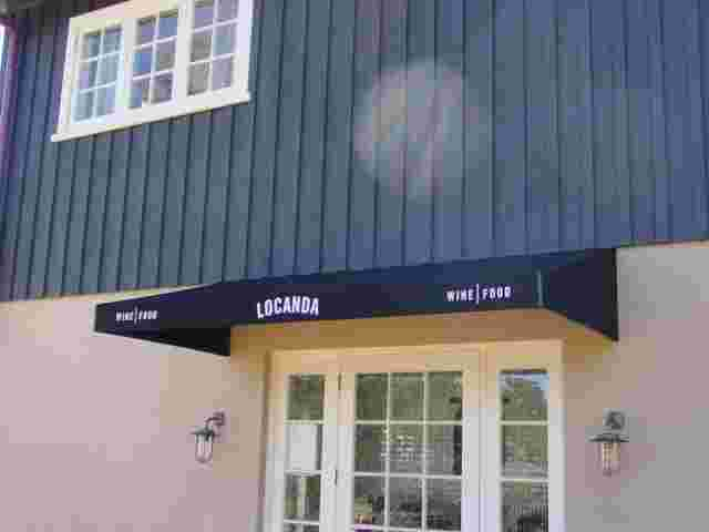 Fixed Frame Awnings - Fixed Frame wedge awning over WIne Tasting room entrance copy.jpg