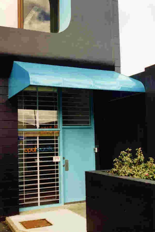 Fixed Frame Awnings - Fixed Frame wedge awning with curved front over office entrance in Auckland 1 copy.jpg