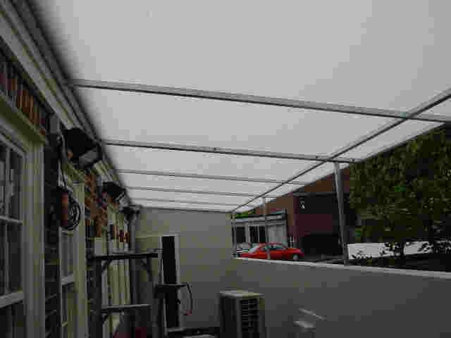 Fixed Frame Awnings - Flat Angled panel Fixed Frame awning over rear courtyard in Parnell copy.jpg