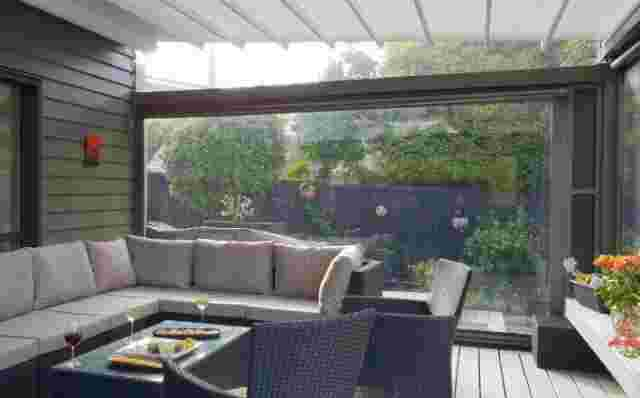 Fixed Frame Awnings - Oztech retractable roof with furniture setting in Meadowbank (1) copy.jpg