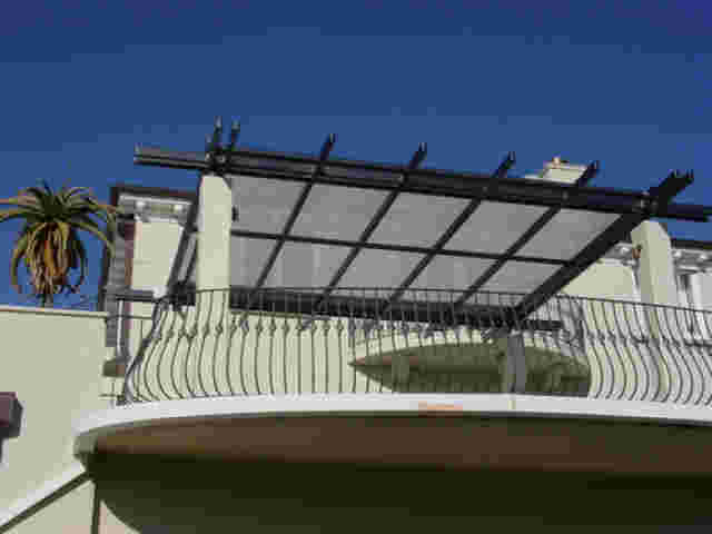 Fixed Frame Awnings - Overhead roller shade on pergola in Remuera 2 copy.jpg