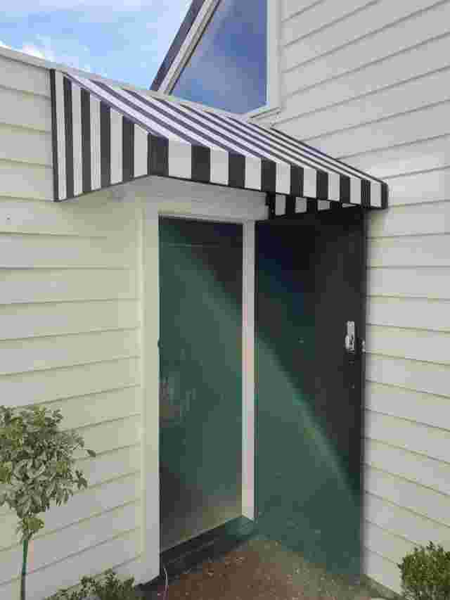 Fixed Frame Awnings - Wedge Doorway awning wih striped fabric copy.jpg