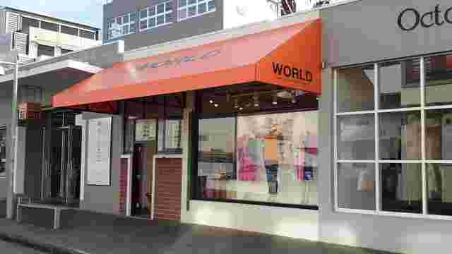Fixed Frame Awnings - Wdge Fixed Frame awning with Orange PVC at World Newmarket copy.jpg