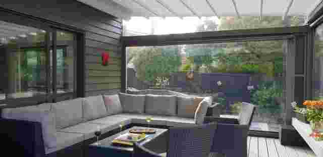 Retractable Roof - Oztech retractable roof with furniture setting in Meadowbank copy.jpg