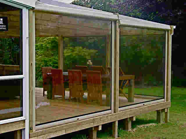 Patio Screens - Chameleon patio screens with head boxes on timber pergola copy.jpg
